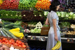Woman shopping in the produce section.
